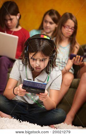 Little Girl Engrossed In Gaming