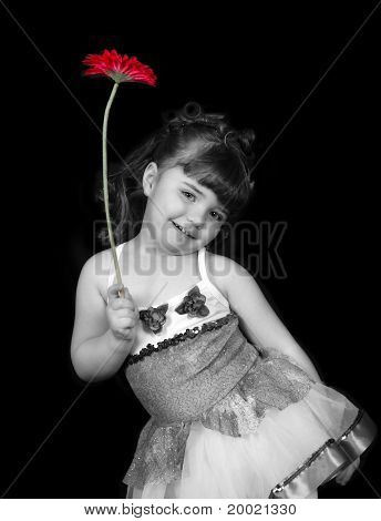 Little Girl In Ballet Outfit Holding Flower In Black And White C