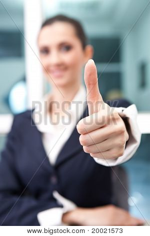 Young Businesswoman Giving A Thumbs Up