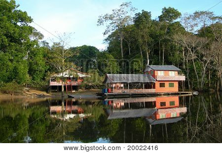 Houseboat in rainforest in Brazil