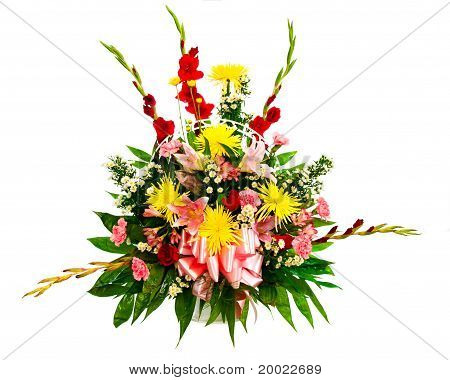 Colorful flower bouquet in basket isolated on white.