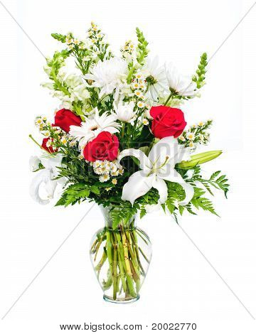 Colorful flower bouquet in vase isolated on white.