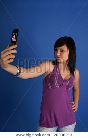 Brunette taking autoportrait