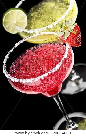 One Classic And A Strawberry Margarita In Front Of A Black Background