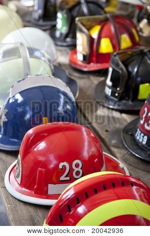 Several Fireman Helmets In Row