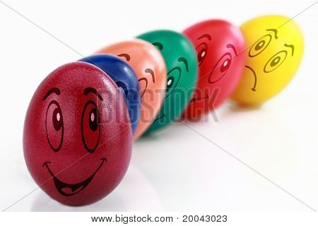 Colored Easter Eggs With Drawn Funny Faces In A Row