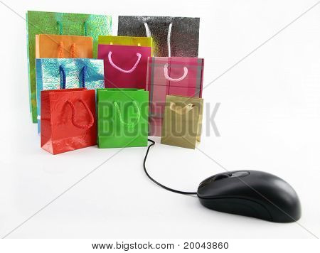 Computer Mouse Connected To A Group Of Shopping Bags