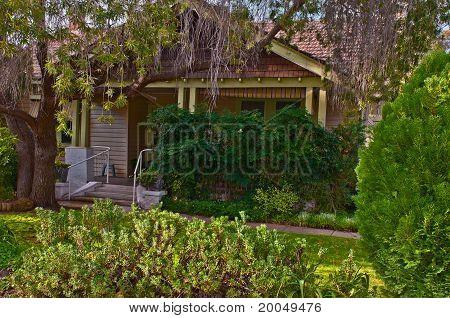 Cottage And Luxurient Garden
