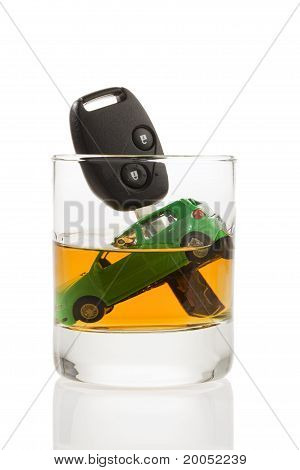 Car keys and glass with alcohol