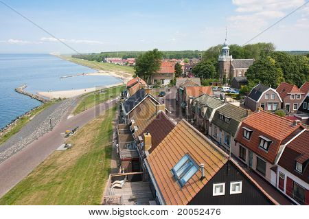 Seafront Of A Dutch Fishing Village Seen From The Lighthouse