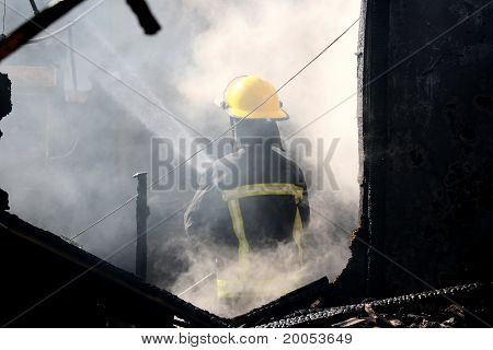 Fireman And Smoke In House