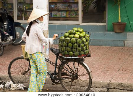 Women Selling Fruit In Vietnam