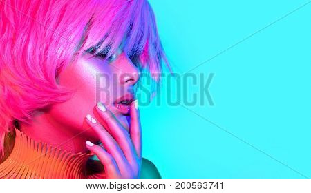 poster of Fashion model woman in colorful bright lights, portrait of beautiful party girl with trendy make-up,