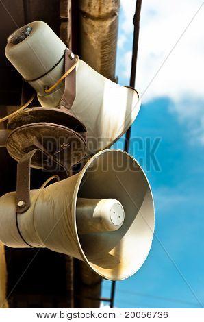 Loudspeakers Against Blue Sky