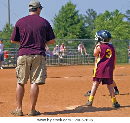 Father Coaching Daughter's Softball