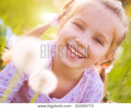 Cute little girl  on the meadow
