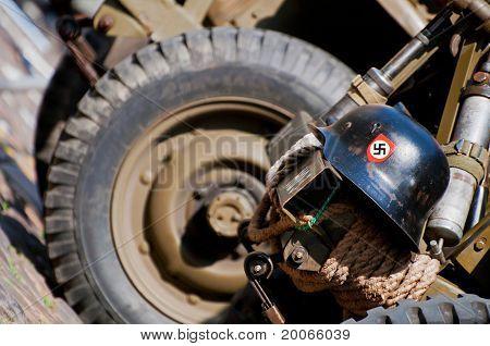 Nazi Helmet On American Jeep