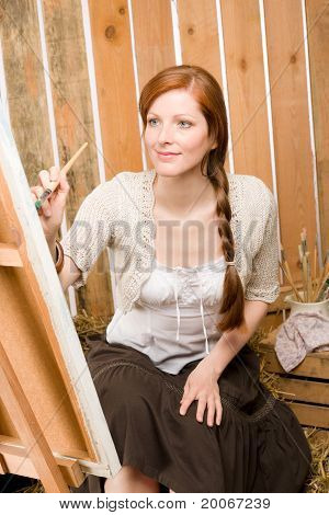 Red-hair Romantic Woman Painting In Barn