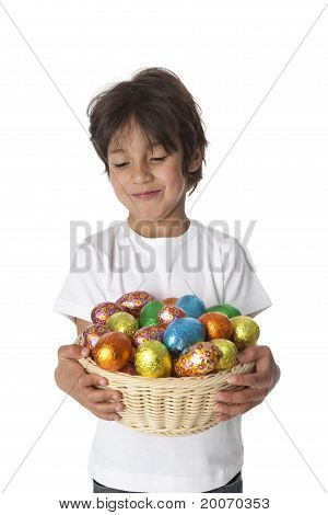Little boy with chocolate Easter eggs