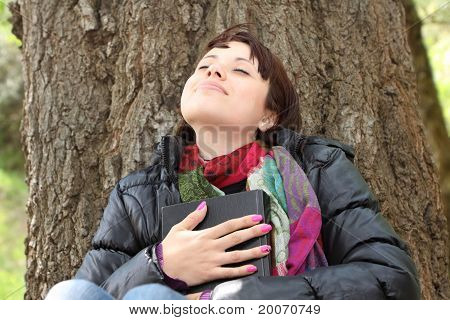 Girl Holding Bible Close