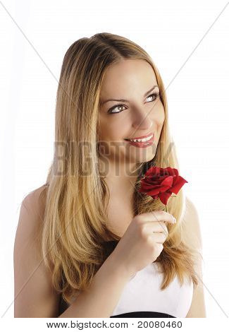 Beautiful woman holding a flower