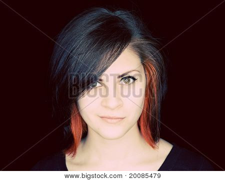 A Young Woman With Funky Hair On A Black Background.