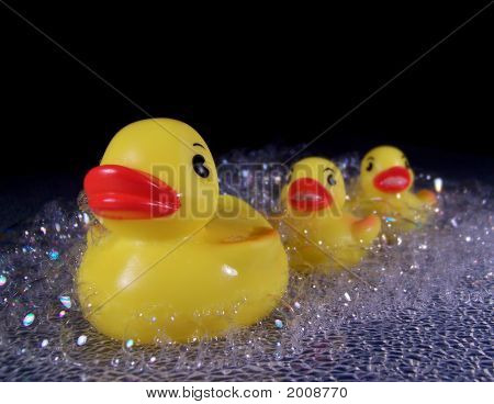 Three Rubber Ducks In Soap Suds