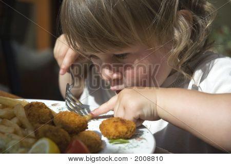 Little Girl Eating French Fries