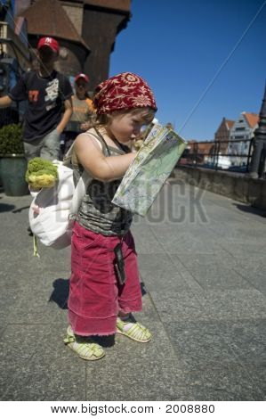 Little Girl With A City Map. Travel