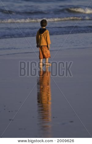 Boy In Orange At Sunset