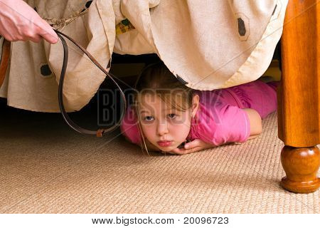 The Child Hides Under A Bed. Violence In A Family.