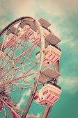 stock photo of ferris-wheel  - Vintage ferris wheel with old film look - JPG