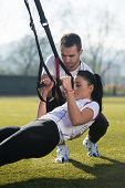 Sports Couple Training With Trx Fitness Straps poster