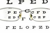 stock photo of snellen chart  - Eyeglasses and snellen eye chart - JPG