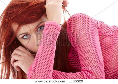 Mysterious Redhead In Pink Fishnet
