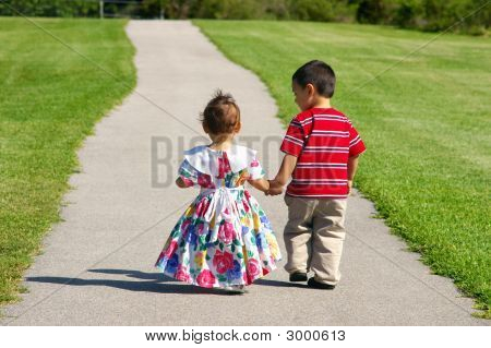 Children Walking Together On A Path