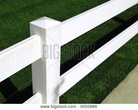 White Fence With Green Turf