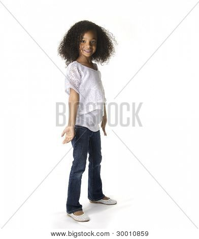 Full length portrait of a cute little African American girl dancing against white background