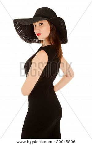Beautiful Woman With Red Lips  In Little Black Dress And Hat