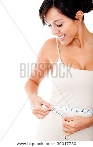 Woman measuring her waist trying to lose weight - isolated over white