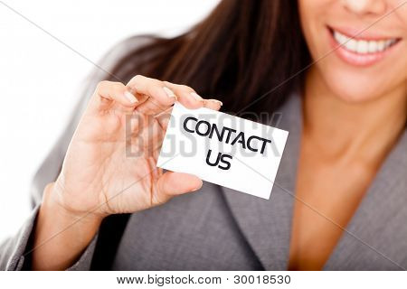 Woman displaying a contact us business card - isolated over a white background