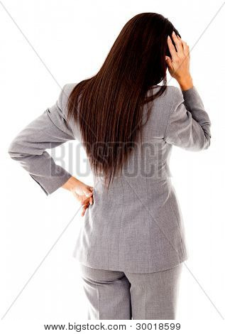 Business woman having problems scratching her head - isolated over white