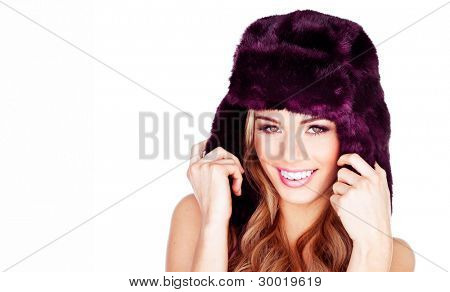 Pretty smiling blonde girl wearing fur hat with ear flaps