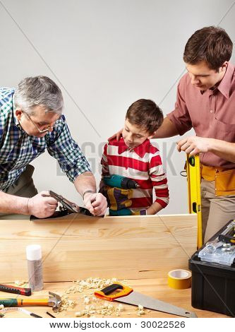 Male members of the family spending time together in a woodshop