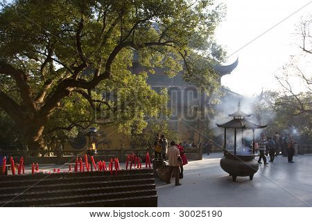 HANGZHOU, CHINA - NOVEMBER 26: Red candles fill the altar at the Mahavira Hall, Lingyin Temple on November 26, 2011 in Hangzhou, China. Buddhism is enjoying a revival in modern liberal China.