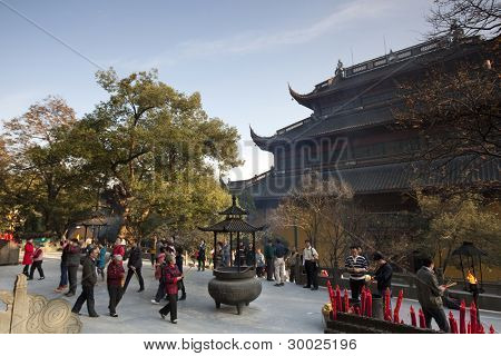 HANGZHOU, CHINA - NOVEMBER 26: Visitors and devotees throng the Mahavira Hall of Lingyin Temple on November 26, 2011 in Hangzhou, China. Buddhism is enjoying a revival in modern liberal China.