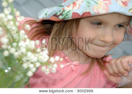 Niña y flores