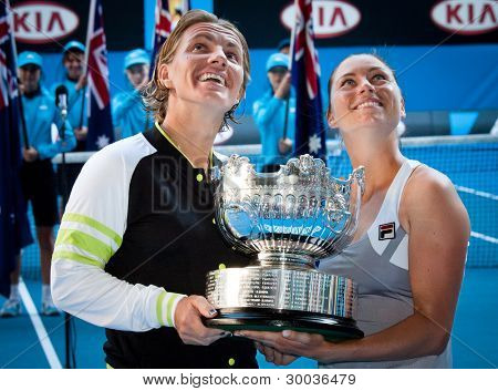 MELBOURNE - JANUARY 27: Svetlana Kuznetsova and Vera Zvonareva of Russia winning the doubles championship at the 2012 Australian Open on January 27, 2012 in Melbourne, Australia.