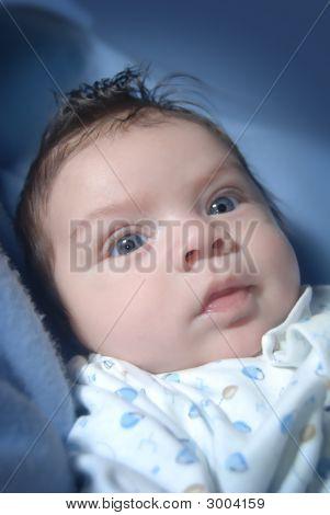 Blue Eyed, Dark Hair Infant - Close Up