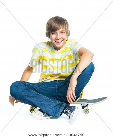 blond boy on sitting on skateboard